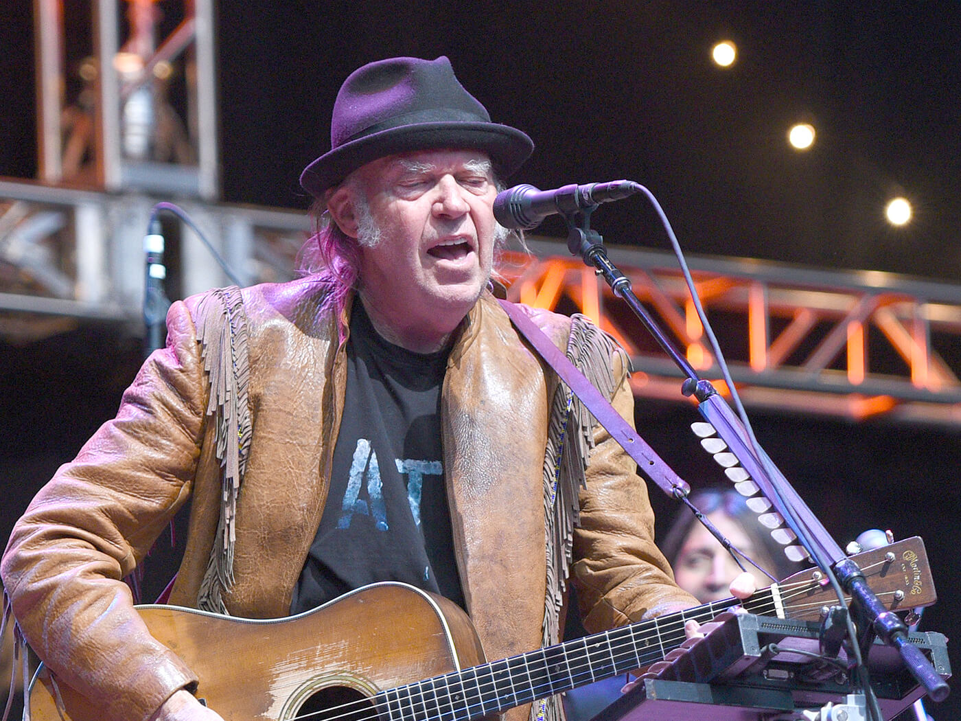 "Watch Neil Young play ""Heart Of Gold"" live from his fireside"